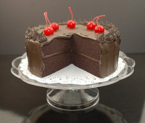 Fake Food Fudge Cake With Slice Out On Pedestal Tray