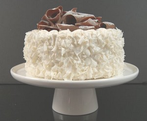 Fake Food Coconut Cake With Chocolate Swirls Top on Cake Pedestal