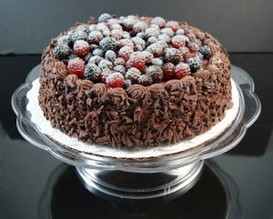 Fake Food Chocolate Cake With Assorted Berries On Pedestal Tray