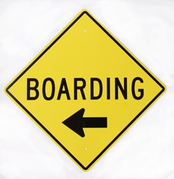 Boarding With Left Arrow Yellow Metal Sign