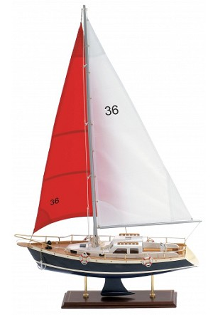Dark Blue Model Sailboat With Red Sail
