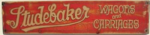 Studebaker Wagons Old West Sign