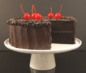 Fake Food Fudge Cake With Slice Out on Cake Pedestal